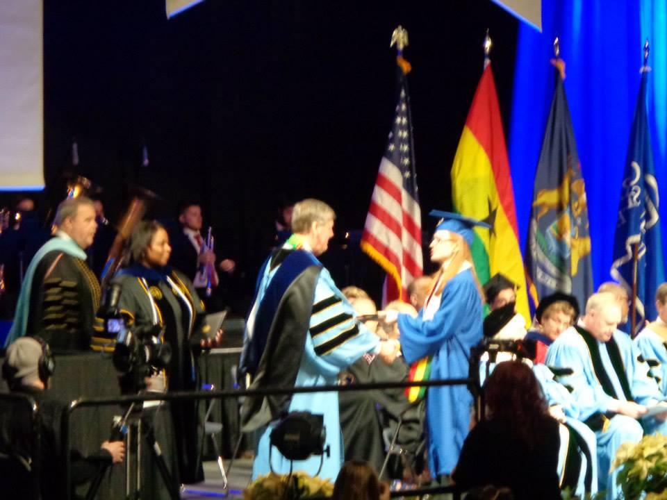 Briana receives the BSN degree from GVSU president Haas.